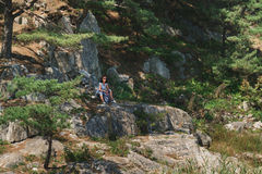 Hiker woman resting on stone outdoor Stock Photography