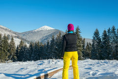 Hiker woman resting  in the winter wood  and enjoys views. Stock Image