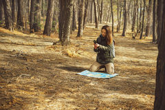 Hiker woman searching direction in the forest Stock Photo