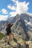 Hiker woman shows Mont Blanc glacier Stock Image