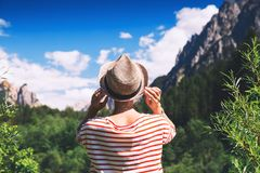 Hiker woman spend summer holiday in Dolomites, South Tyrol, Ital Royalty Free Stock Images