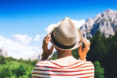 Hiker woman spend summer holiday in Dolomites, South Tyrol, Italy, Europe. Hiker woman outdoors on nature. Travel at Dolomites, Italy, Europe. Summer holiday in royalty free stock image