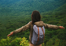 Hiker woman standing with raised arms on mountain Royalty Free Stock Image