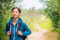 Hiker woman in the summer forest Stock Photo