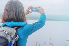 Hiker woman takes photographs on nature Stock Image