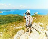 Hiker woman takes photographs the nature Stock Photos