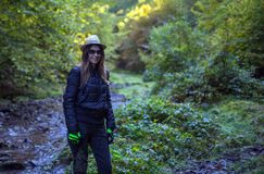 Hiker woman on a trail by the river Stock Photo