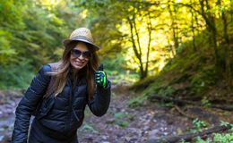 Hiker woman on a trail by the river Stock Photos