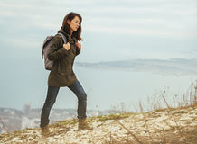 Hiker woman trekking in highlands Royalty Free Stock Images