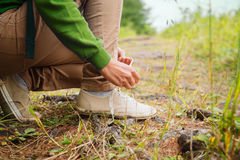 Hiker woman tying a shoelaces Stock Images