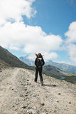Hiker woman walking on forest road in les Alps, France. Stock Images