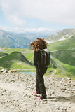 Hiker woman walking on forest road in les Alps, France. Young woman doing trekking activity stock image
