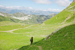 Hiker woman walking on forest road in les Alps, France. Young woman doing trekking activity royalty free stock photos