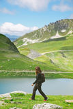 Hiker woman walking on forest road in les Alps, France. Young woman doing trekking activity stock photo