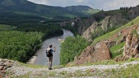 Hiker woman is walking mountain, stock footage