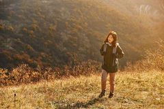 Hiker woman walking in the mountains Royalty Free Stock Photos