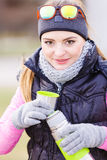 Hiker woman warming up drink tea in cold day Stock Images