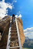 Hiker on wooden staircase Royalty Free Stock Photos