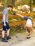 Hiker young couple in nature preparing to hike Stock Image