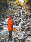 Hiker young girl with cup of tea near a mountain river. Beautiful nature in the mountains. stock image