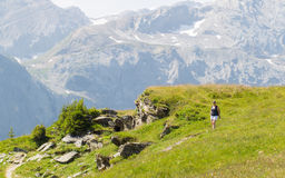 Hiker, young woman with backpack Stock Image