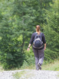 Hiker, young woman with backpack Royalty Free Stock Images