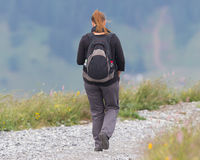 Hiker, young woman with backpack Stock Photography