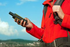 Hiker young woman holding in her hand GPS Stock Images