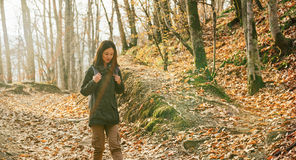 Hiker young woman walking in autumn forest Royalty Free Stock Photography
