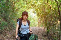 Hiker young women walking in national park with backpack. Royalty Free Stock Photos