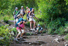 Hikers. Go down on a stony track royalty free stock images