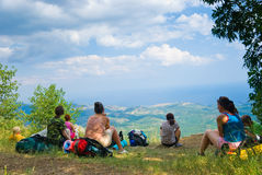 Hikers. Have a rest on a hillside Stock Photography