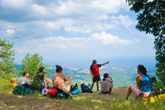 Hikers. Have a rest on a hillside Royalty Free Stock Images