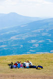 Hikers. Have a rest on a hillside Stock Photos