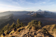 Hikers admire the spectacular view of Mount Bromo during early morning Royalty Free Stock Photo