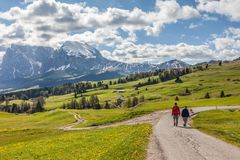 Hikers on the Alpe di Siusi. South Tyrol, Italy Stock Photo