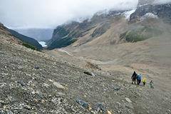 Hikers on the alpine trail in the Canadian Rockies along the Icefields Parkway between Banff and Jasper Stock Photos