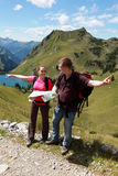 Hikers in the Alps. Male and female hikers in the Germen Alps near Oberstdorf searching the right direction stock image