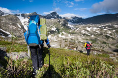 Hikers in Altai mountains Stock Photo