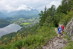 Hikers in Altaussee in Austria stock photography