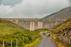 Hikers Approaching Ben Crom Dam stock image