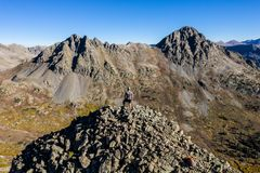 Drone photo - Hikers atop a mountain in the Colorado Rocky Mountains, Sawatch Range. Hikers atop a mountain as seen from a drone. Colorado Rockies royalty free stock photos