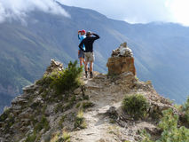 Hikers in autumnal Himalaya. Annapurna Circuit trek in Nepal, Marsyangdi river valley near Ngawal village stock photo