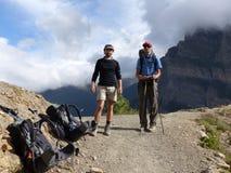 Hikers in autumnal Himalaya. Annapurna Circuit trek in Nepal, Marsyangdi river valley near Ngawal village stock image
