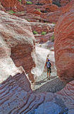 Hikers and Aztec sand stone rock formation in Red Rock Canyon, NV. Stock Photography