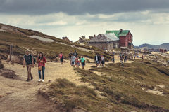 Hikers at Babele chalet, Romania Stock Photos