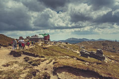 Hikers at Babele chalet, Romania Stock Photo
