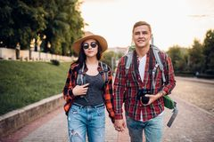 Hikers with backpack go sightseeing, summer hiking. Hikers with backpacks go sightseeing in tourist zone. Summer hiking. Hike adventure of young men and women on stock photo