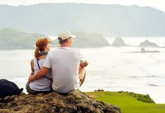Couple enjoying the company of each other on top of the hill loo Stock Photos