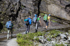 Hikers with backpack on trekking trail in Himalayan mountains. Nepal royalty free stock images